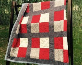Red, gray, and white stadium quilt - quarters style