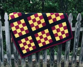 Maroon and gold checkerboard stadium quilt