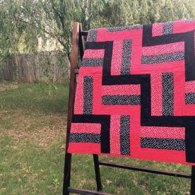 Red and black rail fence stadium quilt
