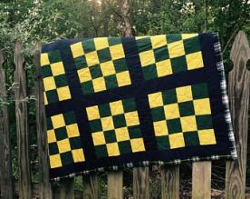green, gold, and navy blue checkerboard stadium quilt