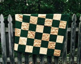 green and gold stadium quilt