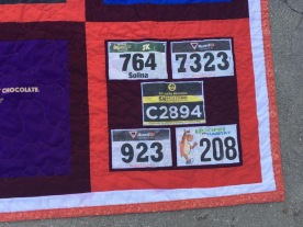 I scanned running bibs and incorporated them into the bottom two corners of the quilt.