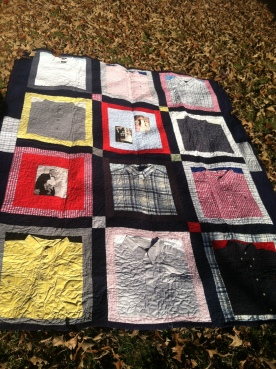 A memory quilt made from dress shirts. I managed to keep the collars on and featured.