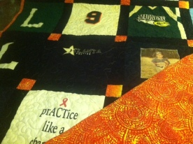 Another graduating senior quilt. This one had a spunky orange batik backing.
