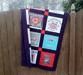 A runner lap quilt. It has the oldest shirt I've ever cut - from 1979.