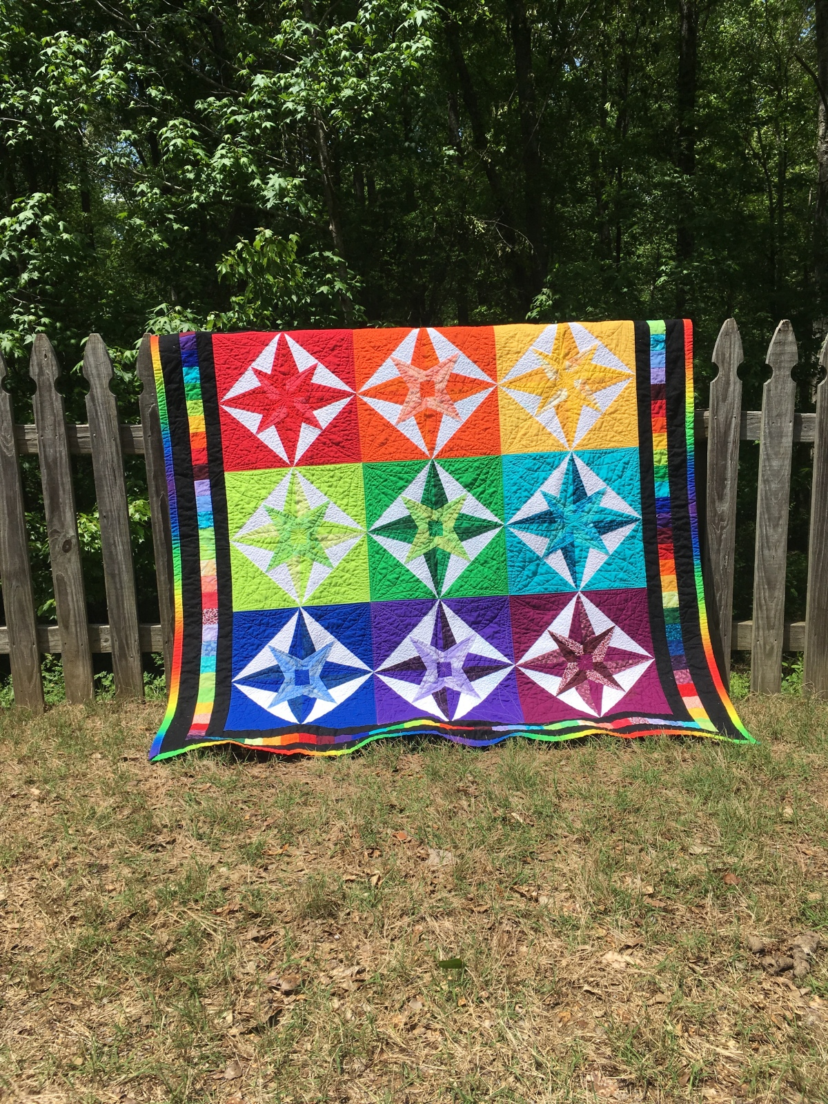 Rainbow Mariner's Compass Quilt